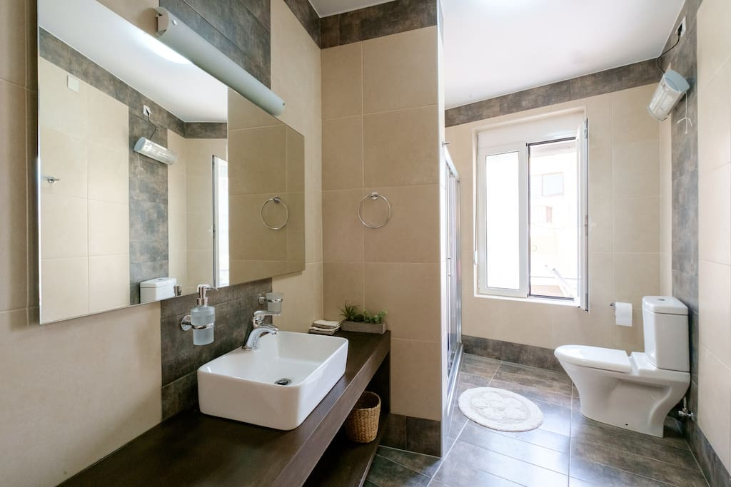 On the bedroom floor, there is another large shower/WC bathroom