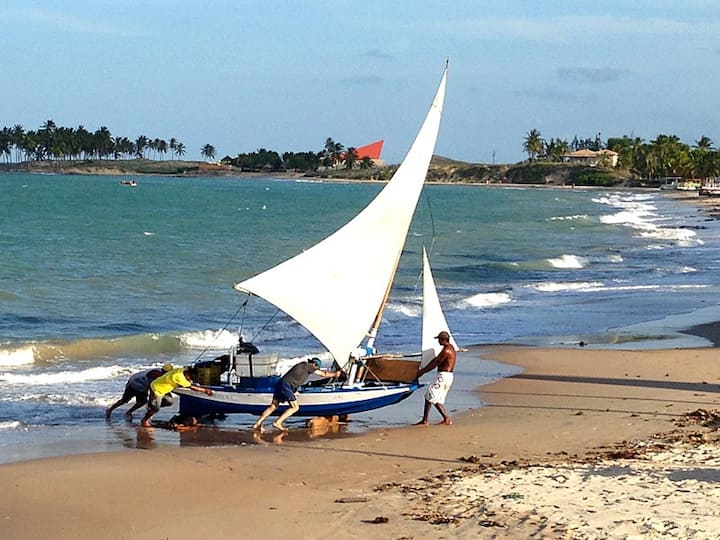 Casa nativa na praia de Maracajaú