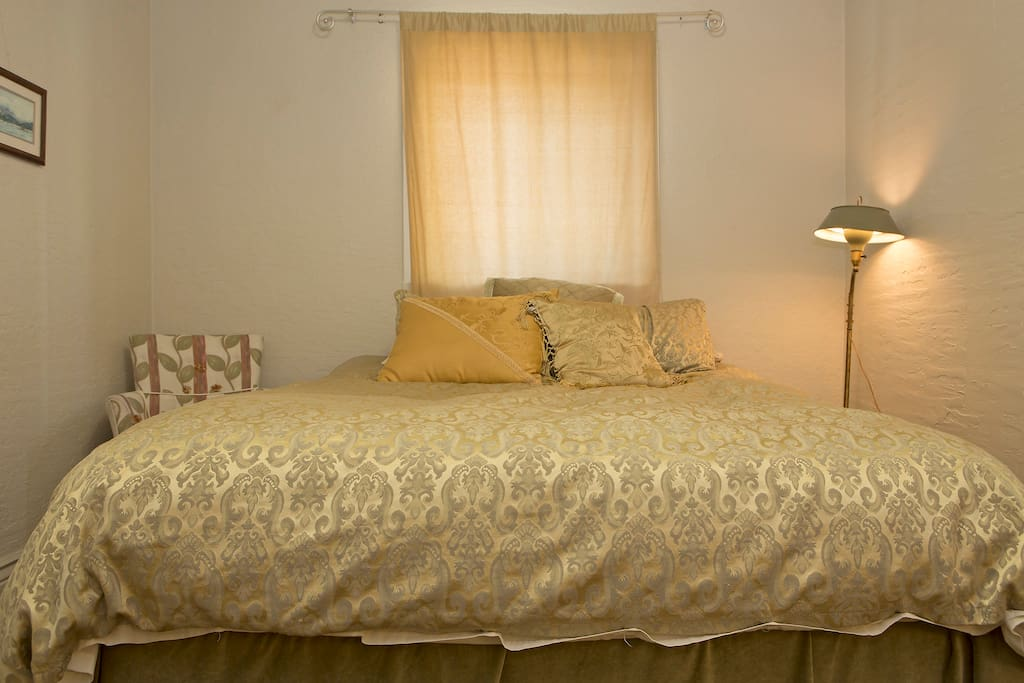 Queen size bed with fluffy down comforter