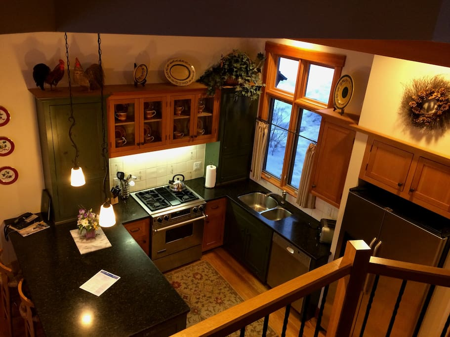 The fully equipped gourmet kitchen features all stainless steel appliances including a full sized refrigerator/freezer, dishwasher, Jenn-Air oven, microwave, coffee maker, butler's pantry and granite counter tops.