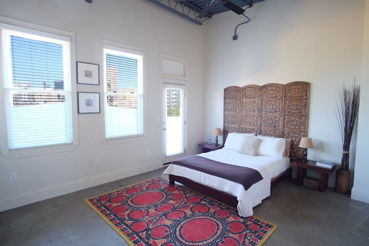Master Suite with downtown view and balcony access