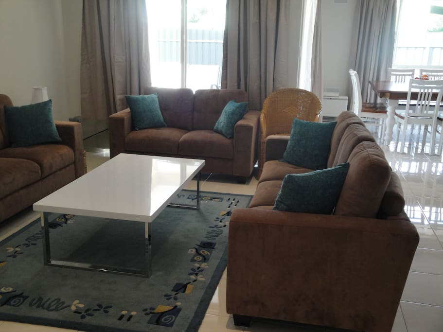 Lounge with plenty of comfortable sofas and large flat-screen TV..