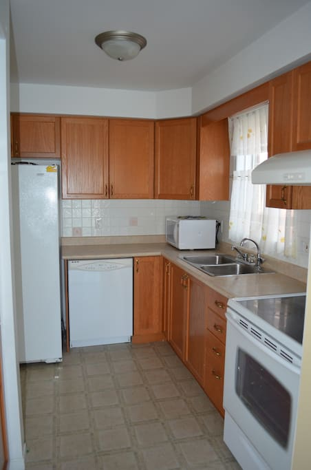 Shared kitchen, equipped with refrigerator, 4 burners electric  stove & oven, dishwasher and microwave.