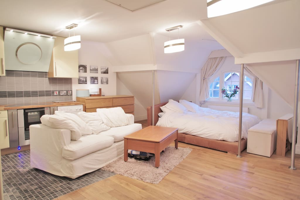 studio room with comfy three-seater sofa and coffee table