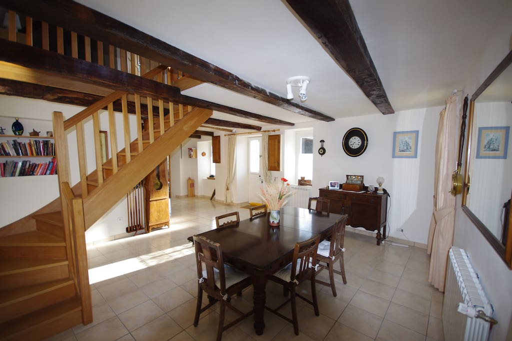 Dining area, the table is also a snooker table. Stairs go up to the TV lounge and two bedrooms