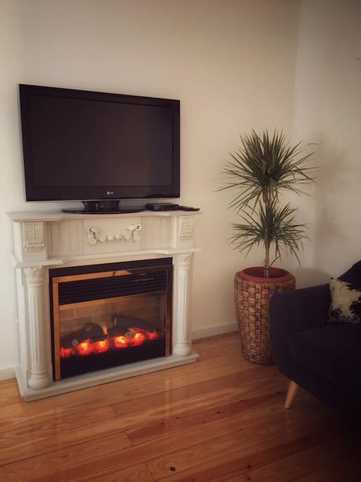 living room - electric fireplace + tv