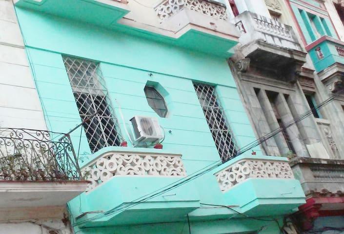 CasaGret, two balconies on a Havana street.