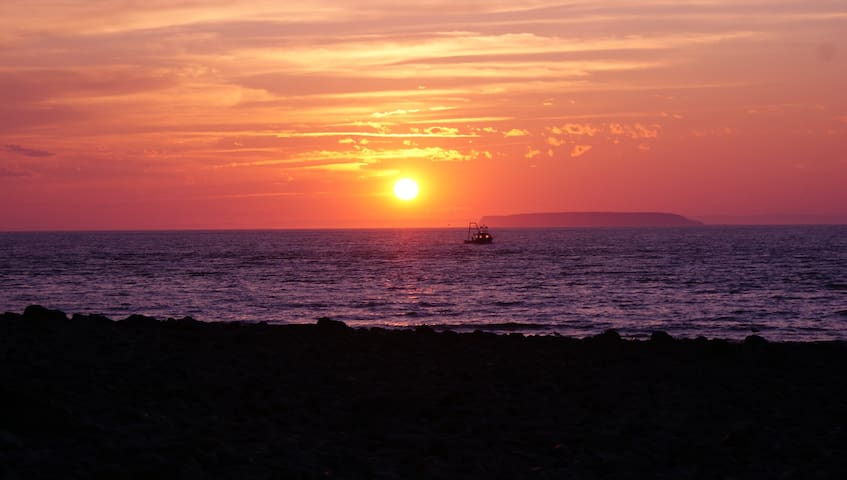 A summer sunset taken from the beach just below the cabin - with the Isle of Haut in the distance