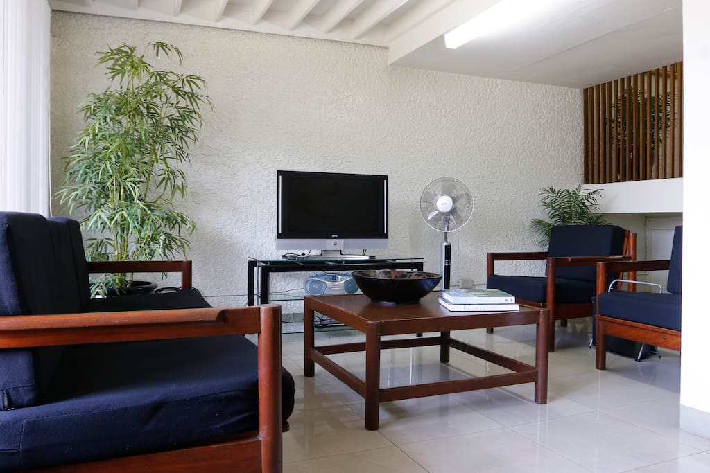 Large lounge room with TV, radio and DVDs.