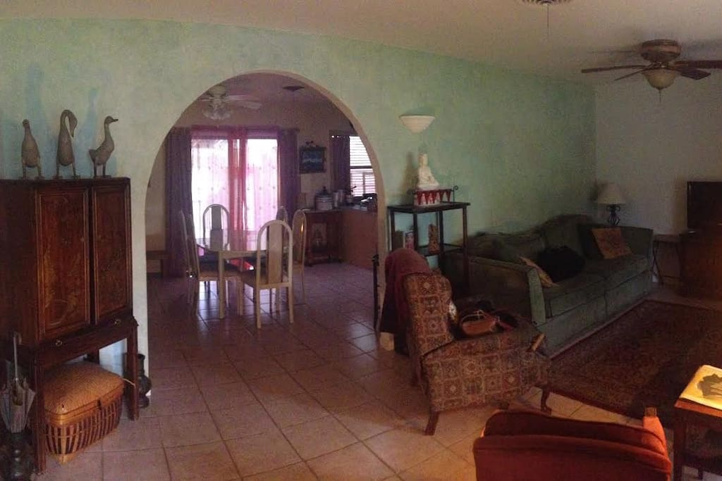 Living room to dining room to  sleeping porch view.
