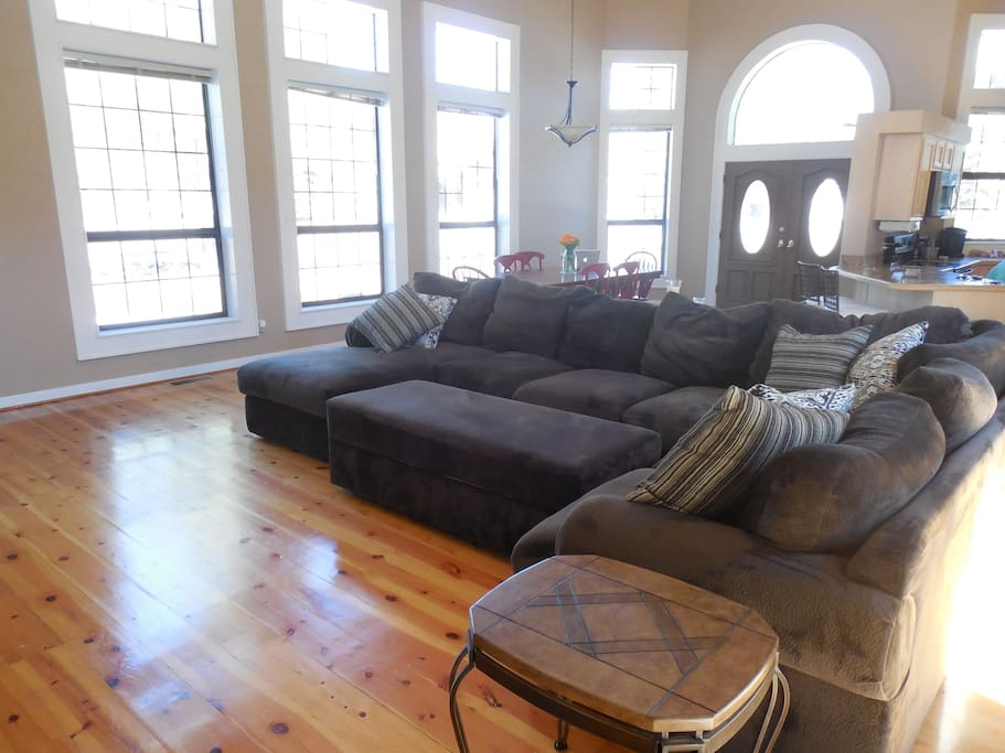 Extra large family room with floor to ceiling windows
