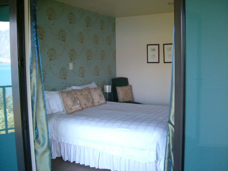 Guest bedroom with direct access to private balcony