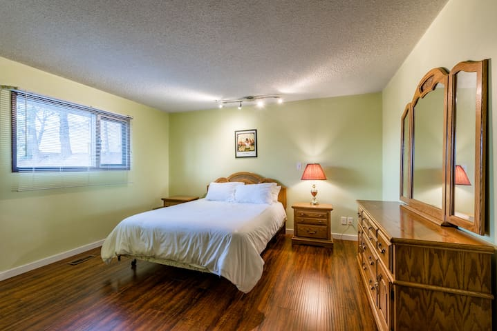 Master Bedroom with a  queen bed, and lots of space.