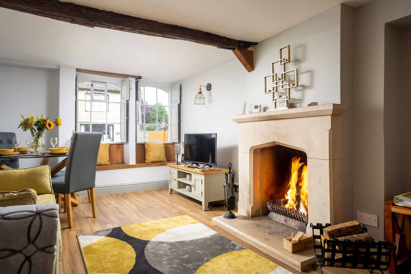 The beautifully presented living room, with a cosy real fire