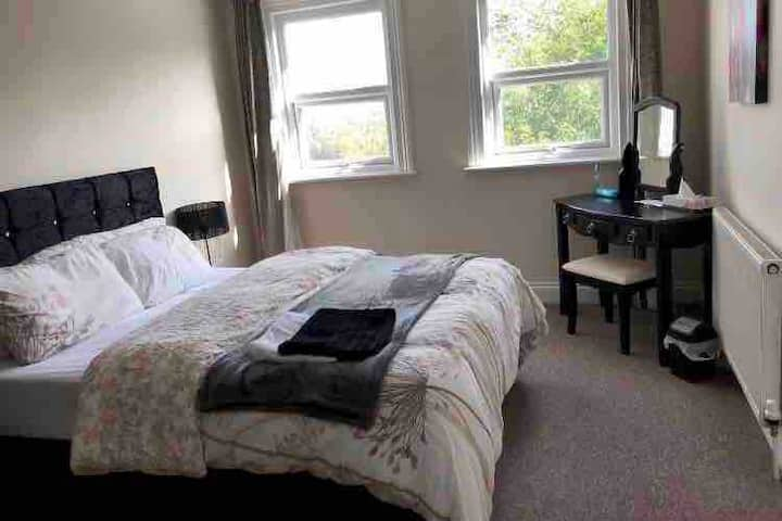A very spacious bright room with beautiful views