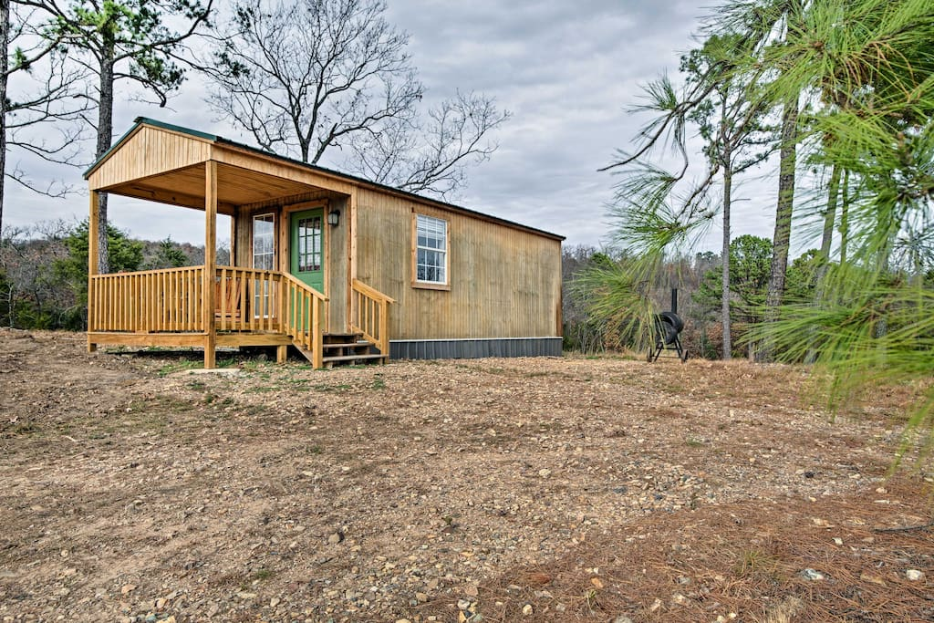 This rustic home is nestled within sight of the Kiamichi Mountains!
