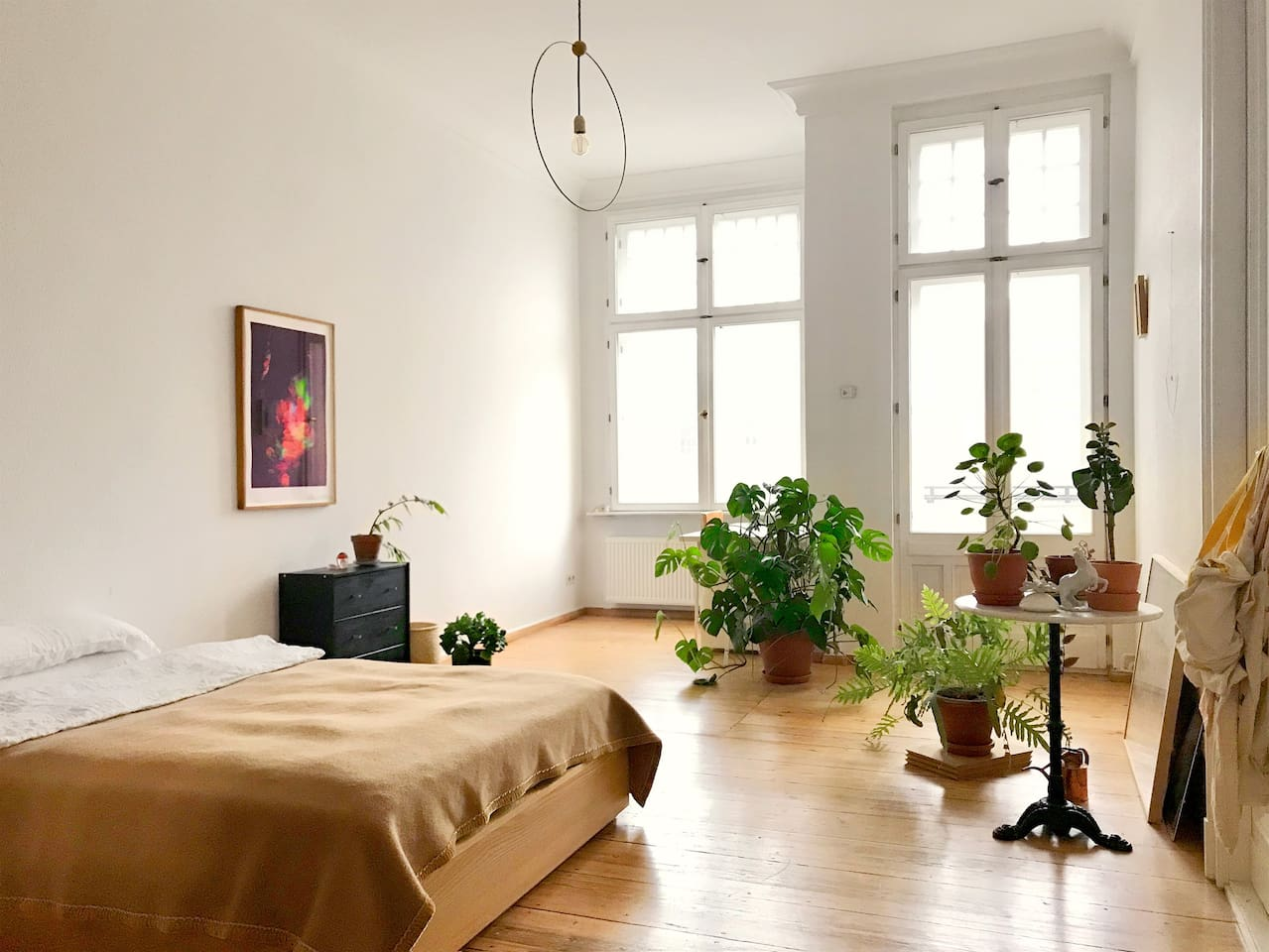 Bedroom with bed, table and balcony