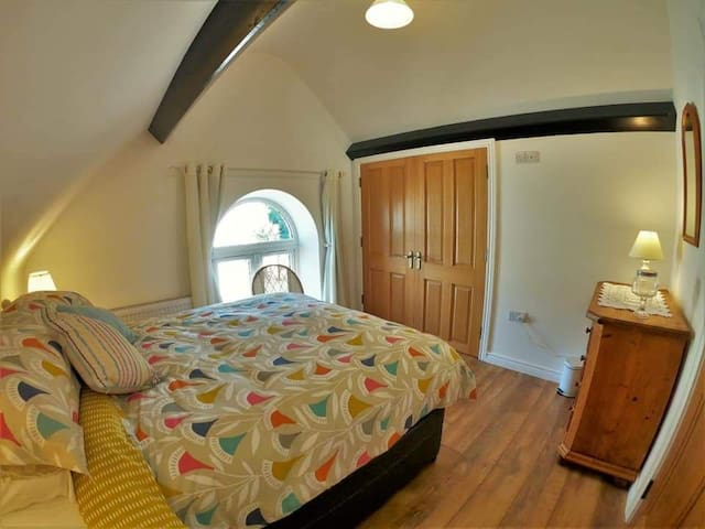 Upstairs bedroom with built-in wardrobe