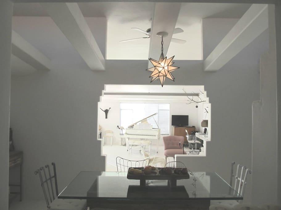 High ceilings, beams in dining room