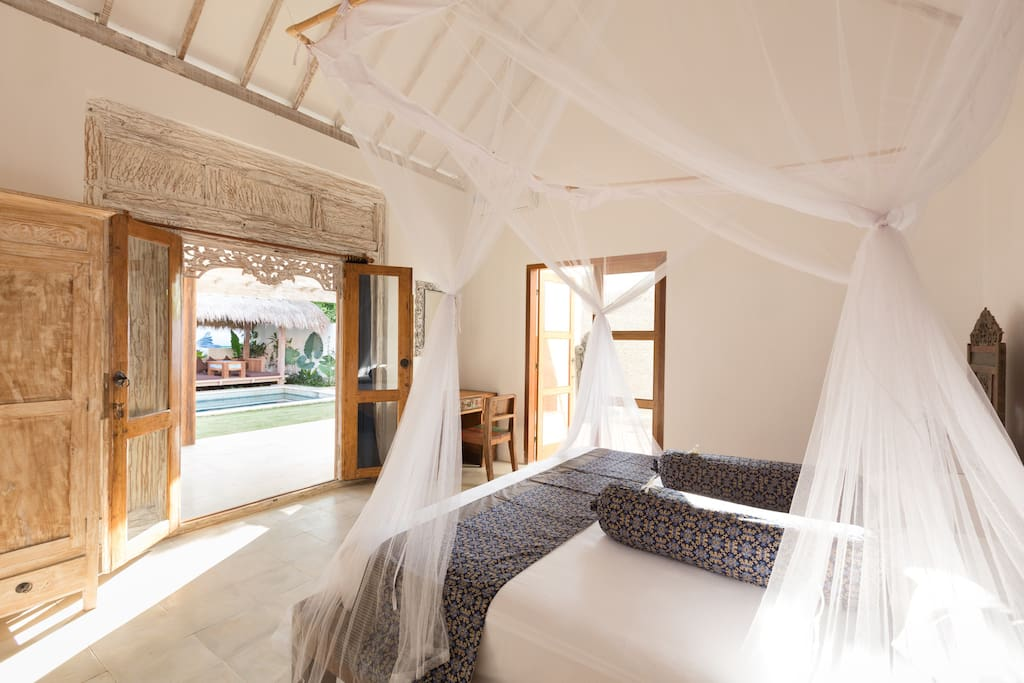 Canopy beds  and large windows let in plenty of light.