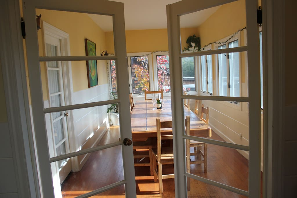 Dining room with custom table that seats 12