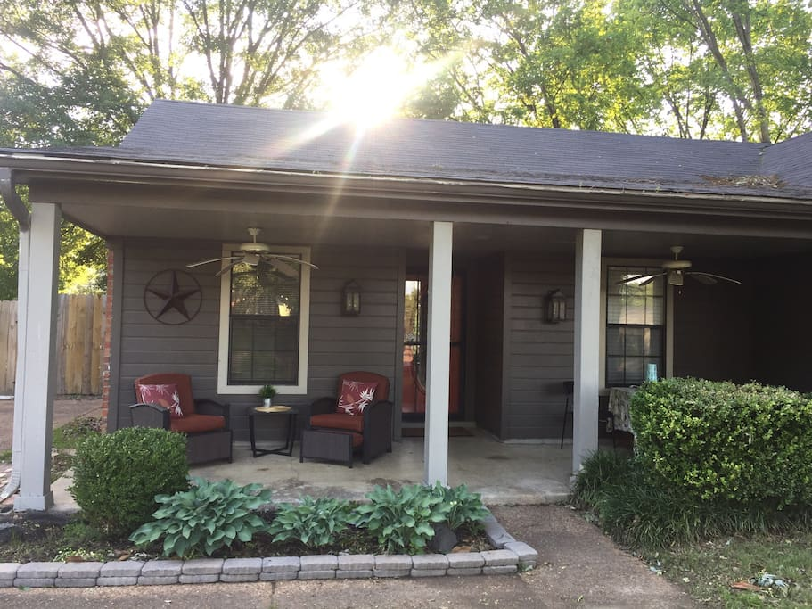 Comfy front porch to relax / unwind on in a quiet neighborhood.