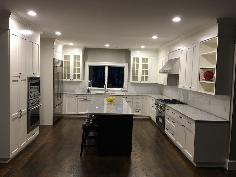 Designer cabinets and Sub Zero fridge, with Thermador gas stove and appliances