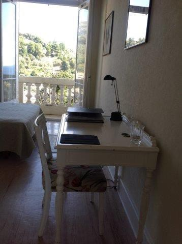 Small desk in the bedroom  and  the balcony with beautiful view.