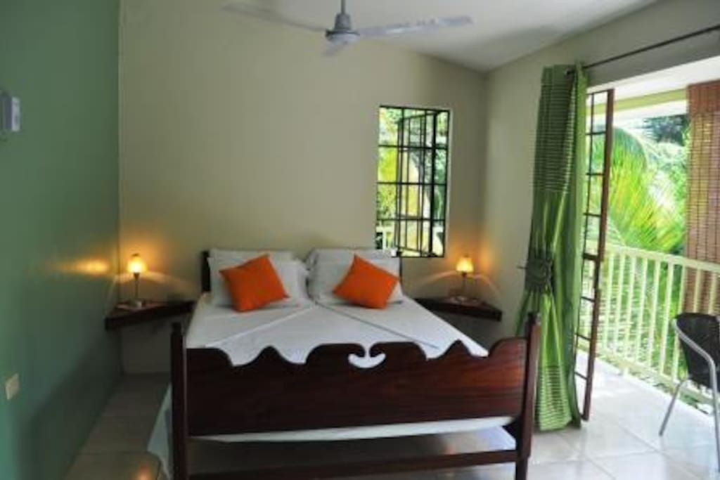 This is the queen sized bed in the Rainforest room.