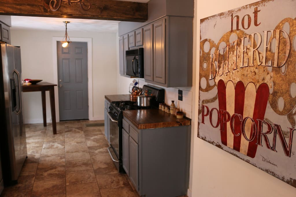 kitchen with re-purposed bowling alley lane countertops