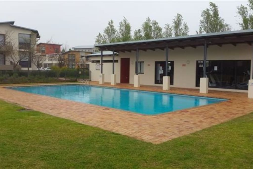 Communal swimming pool, and access to gymnasium.
