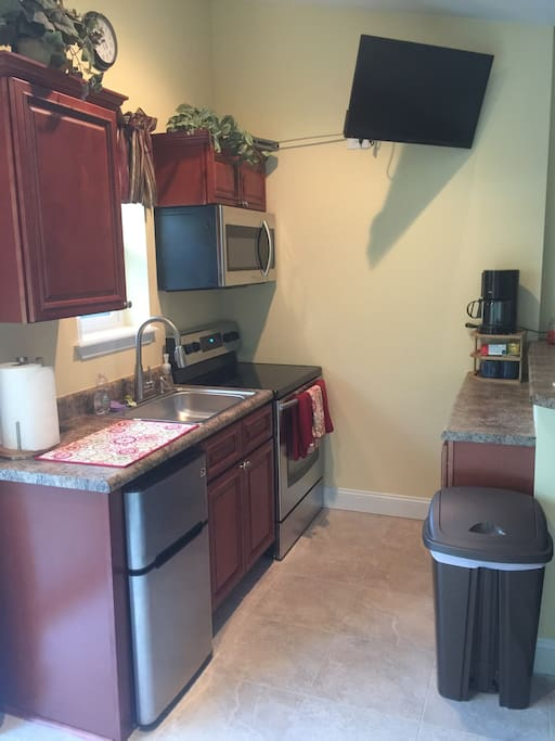 Full kitchen with microwave and coffee maker
