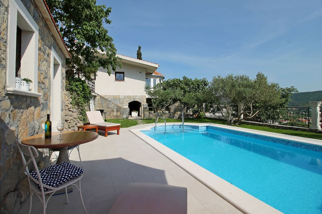 Enjoy in view from the top of village by the pool and traditional summer kitchen