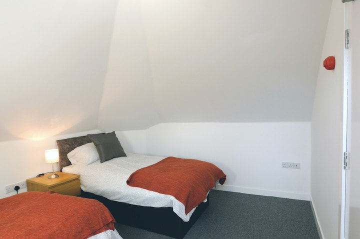Sea View Room 5 with Quality Twin Beds and Private Shower Room