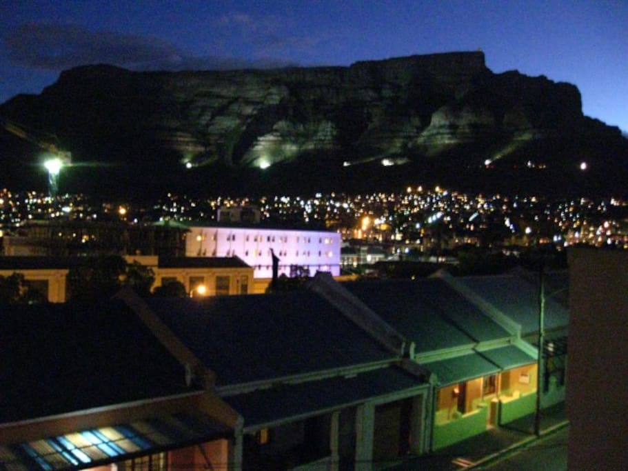 Table mountain is lit up in summer above lights of the city bowl