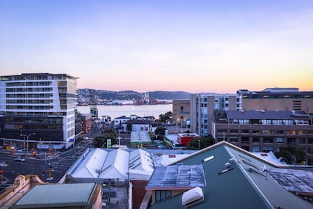 This North-facing apartment is right in the centre of town, just off Courtenay, with an amazing view of the Wellington harbour. It's within walking distance to everything in the CBD and has everything you need for a short to long stay.
