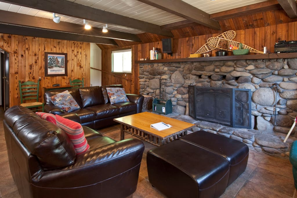 Cozy up by the stone fireplace in the den and watch a movie.