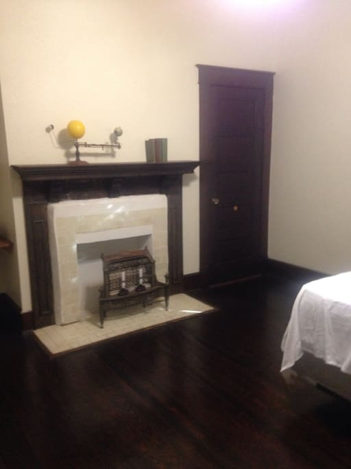 Roomy downstairs bedroom with decorative (non-functional) fireplace.