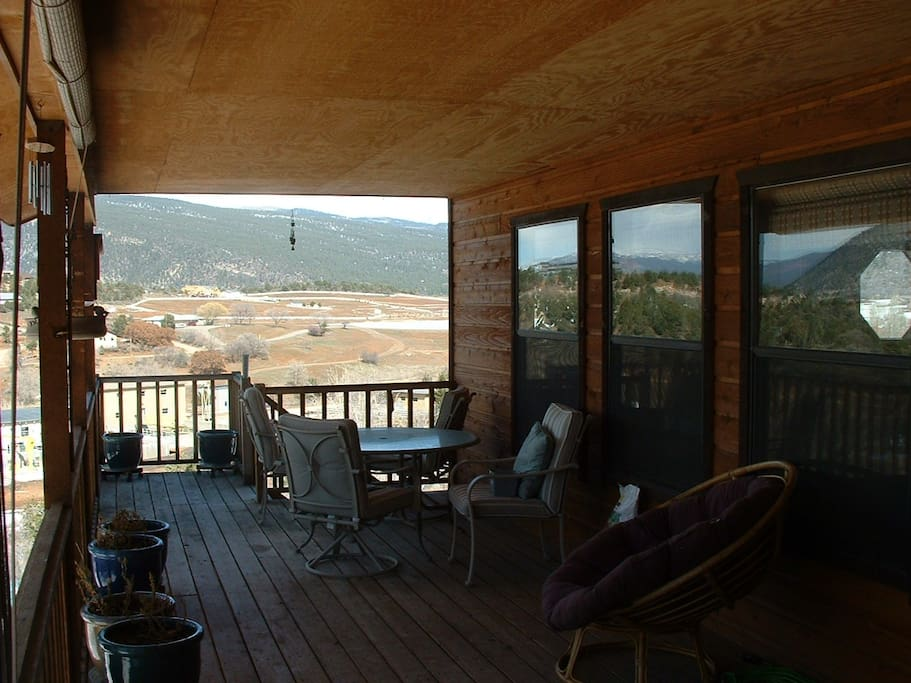 Large covered  deck with view of La Plata Mountains.