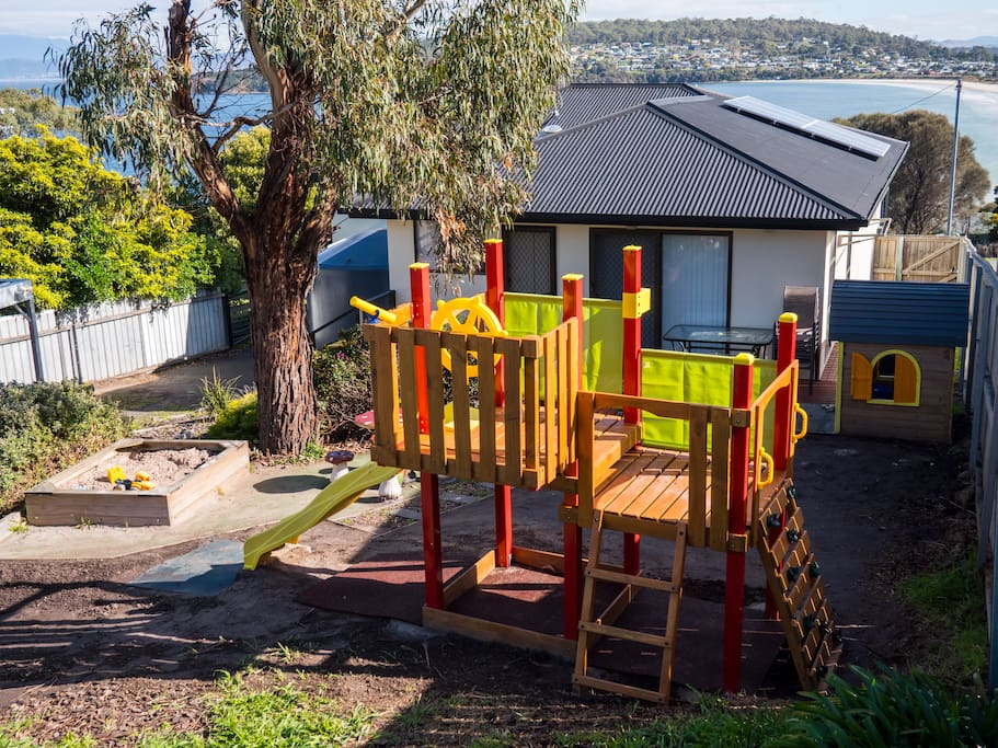 With an awesome playset with rock climbing wall, slide and pirates lookout plus a large sandpit and cubby house your kids won't want to leave!