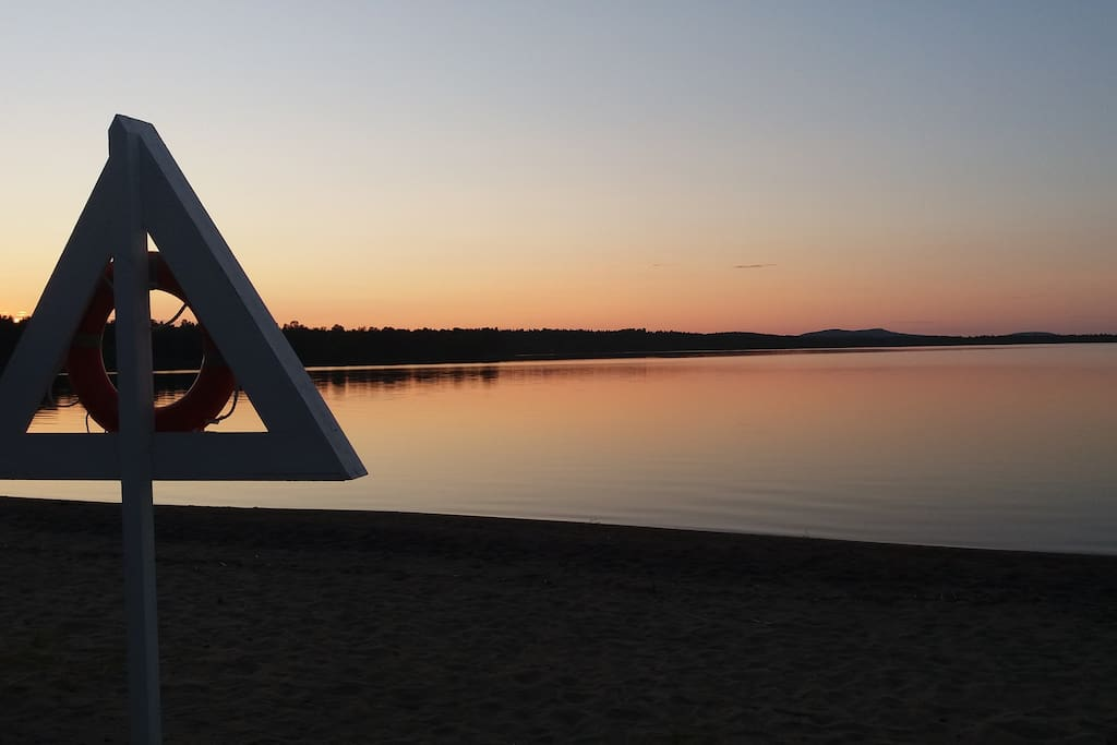 Sunset at nearby beach Sevettijärvi on july.
