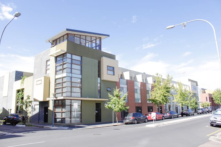 Located behind this buliding is a 3 story city townhouse - secure, modern and quiet.