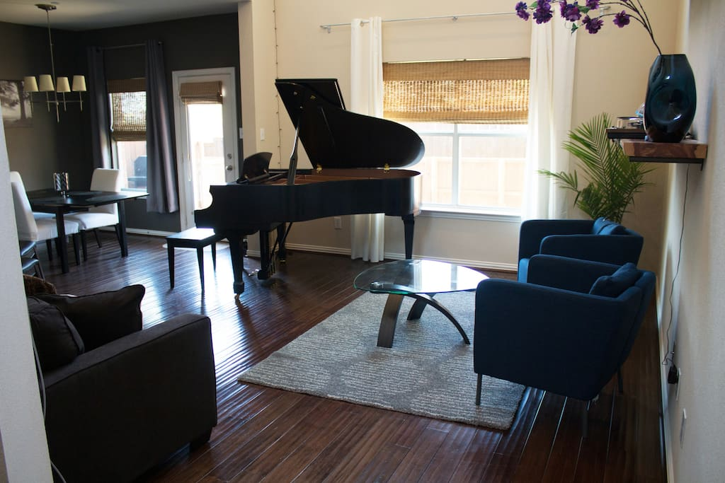 Spacious living room with grand piano