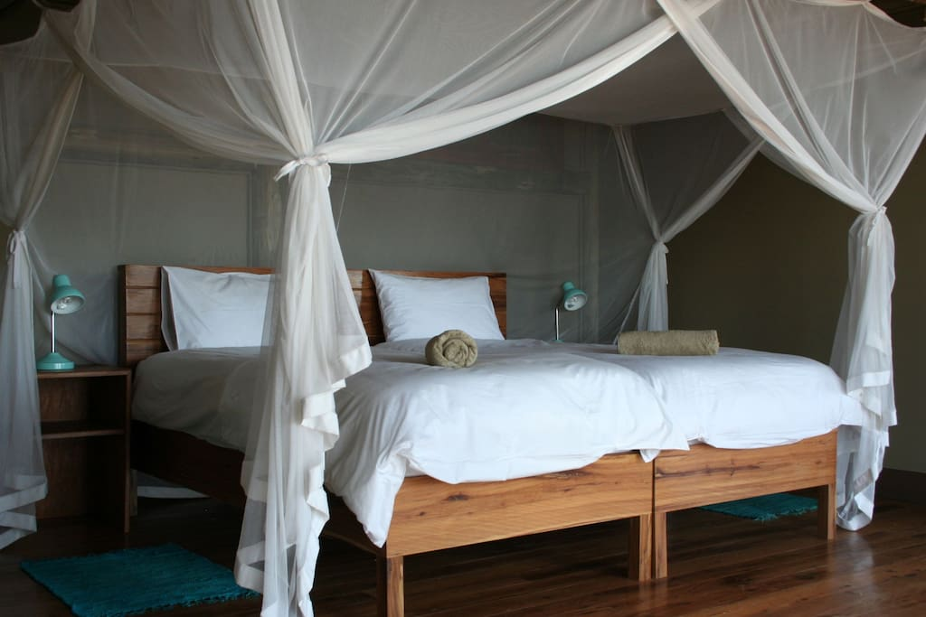 King or Twin Beds in our thatched Casas of Wood/Canvas on elevated decks