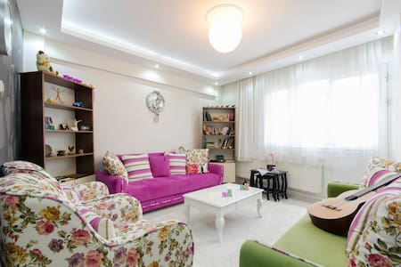 My flat is close one of the main metro station(ucyol), city centre(konak). From airport 1 hour away, internet, hot water, shampoo, heating, 2 fans, can cook like in your house. I don't use TV, no elevator, no air condationer.