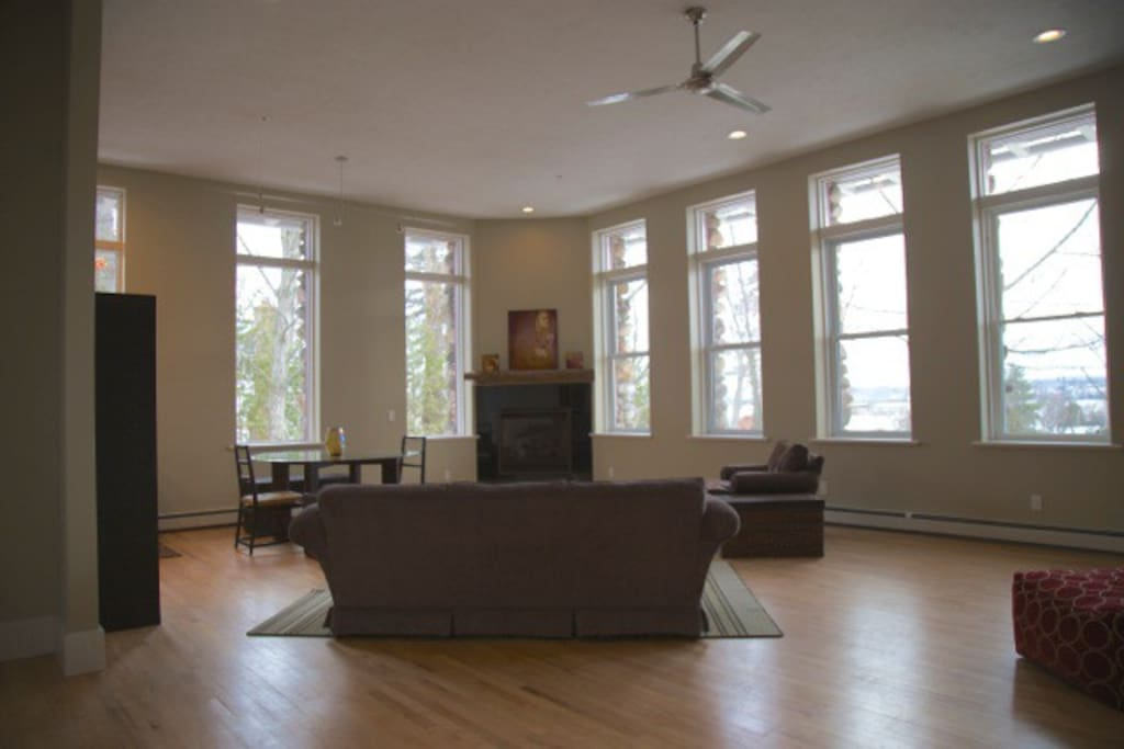 Large living space with 14' ceilings, 8' windows, all LED lighting.