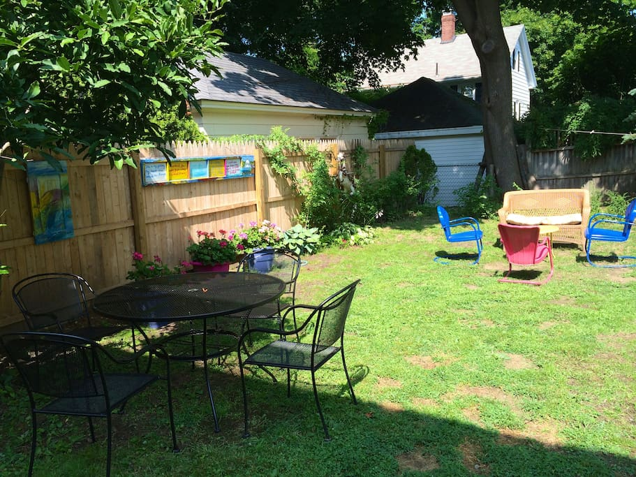 Beautiful backyard with seating and BBQ, clothesline to hang your beach towels and swim suits!