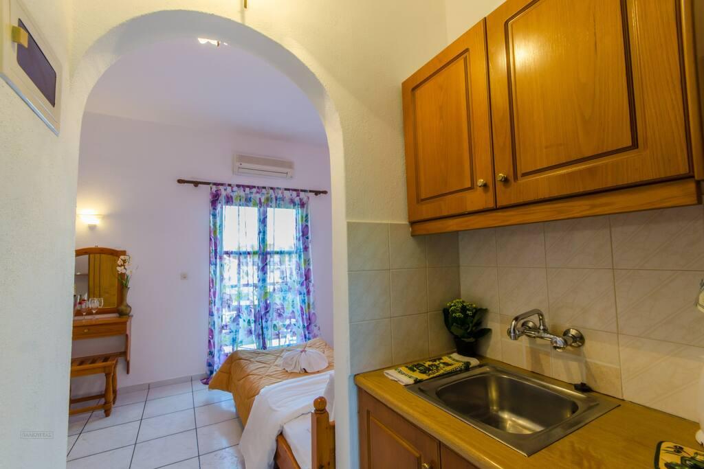Triple Studio with kitchen, bathroom and balcony.