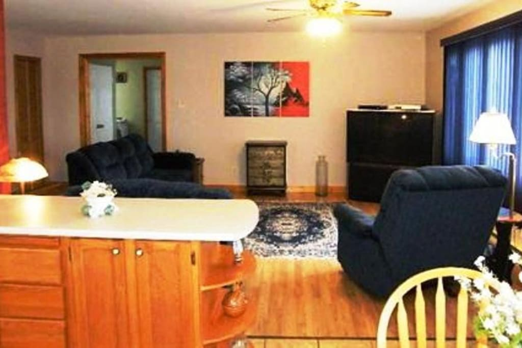 Open Concept Living Room (with entry & laundry area beyond door) from Kitchen/Dining Area