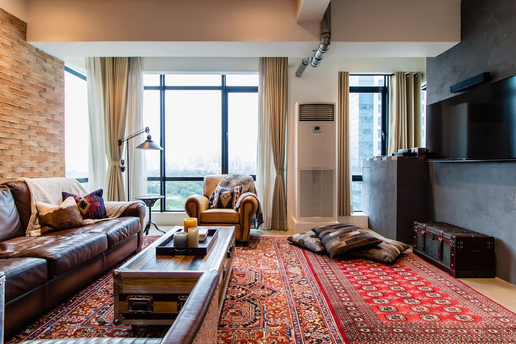 Lounge anywhere in the living room on top of authentic Persian rugs.